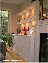 fitted cupboards in alcoves, nice downlighters in shelves