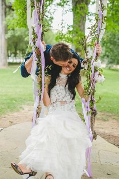Hopelessly romantic garland and ribbon adorned swings for bride and groom photos!  Carnival Inspired Cedarwood Wedding | Cedarwood Weddings #cedarwoodweddings