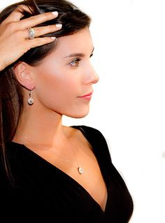 Model wearing John Ford Jewelry made in Gavleston, TX #galveston #jewelry #diamonds #necklace #ring #earrings