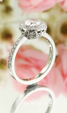 Beaitful rose cut diamond set on an antique style carved band with diamonds along the band.  Be a part of your own ring design! Start from scratch, and draw out the ring beside an artist who can make your dream ring come to life! We can also do this online, with a personal web page assigned to you and your designer. We also have live chat if you have ANY questions throughout the process or how to get started!. #rings #wedding #design #bling #diamond #diamondring #bride #inspiration