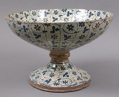 Bowl on Foot Date: 1440–1460 Geography: Made in probably Manises, Valencia, Spain Culture: Spanish Medium: Tin-glazed earthenware Dimensions: Overall: 8 9/16 x 12 3/4 in. (21.7 x 32.4 cm) Base (Foot): 3 3/16 in. (8.1 cm)