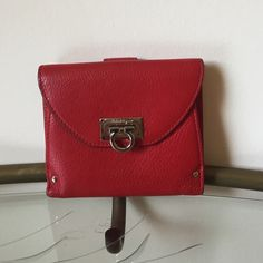 Salvatore Ferragamo red wallet (no trades) Used a few times, but no rips or stains. Excellent condition, comes with dustbag. Please see matching purse Salvatore Ferragamo Bags Wallets