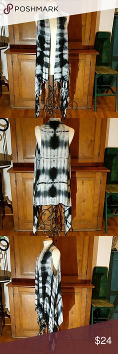 "Tie Dye Long Fringed Vest Super Popular right now a long vest is a Wardrobe Must Have! This one is definitely an attention getter. Wonderful over a dress and perfect to wear with denim, leggings or pants -- even shorts. Grown-up tie-dye in Pretty Periwinkle Blue.  100% Rayon. Length in back 40"", Length to longest point on side 51"" ONE WORLD Tops"