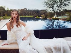 Sunset at the Four Seasons Resort Orlando creates a tranquil, romantic ambience that's a beautiful complement to this dramatic, pearl-embellished gown and cape.