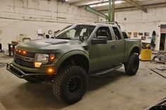 Army green color Special Vehicle Team SVT Ford F-150 off-road Raptor truck