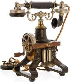 ~ Early Desk Phone - which features a hand-cranked generator to ring the bells of other telephones and to alert the operator. Manufactured by Lars Magnus Ericsson in Sweden - 1892 ~