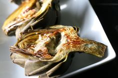 Oven Roasted Artichokes. Just lemon, garlic & butter. Made these tonight & HOLY CRAP are they good!