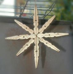 Diy Christmas ornaments. Gold christmas star with clothespins