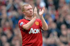 In this file picture taken on May 12, 2013 Manchester United's English midfielder Paul Scholes acknowledges the crowd as he is substituted during the English Premier League football match between Manchester United and Swansea City at Old Trafford in Manchester, northwest England.  Former Manchester United midfielder Paul Scholes has been drafted in to assist the club's newly appointed interim manager Ryan Giggs, United revealed on April 22, 2014.
