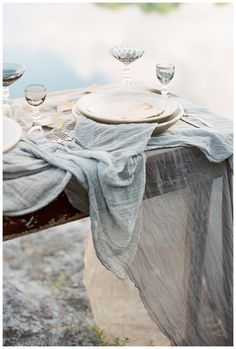 Rustic waterside table with hand dyed silk fabric by Silk & Willow. Styling by Janna Brown Design Co., image by Sleepy Fox Photography.
