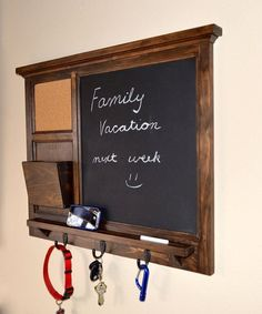 This handmade board provides a chalkboard for notes, tac-board for photos, and a mail-holder all in one product! Best placed in a mudroom or