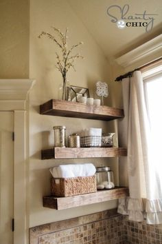 Floating wooden rustic shelves, a beautiful way to present bathroom décor.