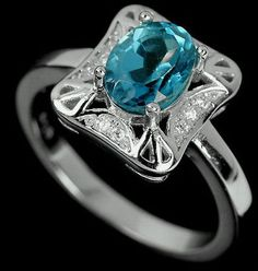 Silver ring with natural London Blue topaz and fianits. The stone is from Brazil 154$
