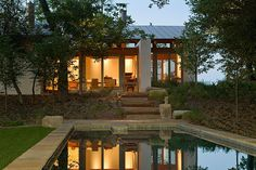 double height living room, also retaining wall and steps to pool