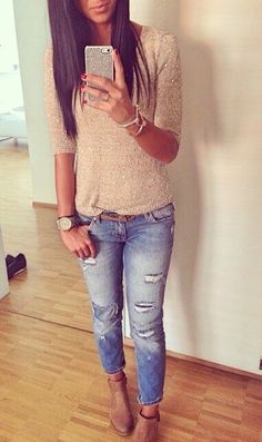 Casual day in a cream / tan tee and medium blue wash jeans and tan nubuck ankle booties. Looks gorgeous with her dark tan skin hair color. Summer casual women's outfit.