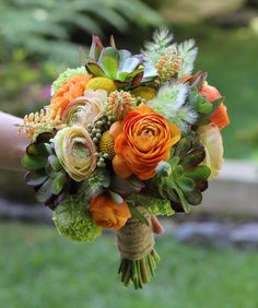 great combo of textures and colors.  grasses, succulents, green viburnum, orange ranunculus. sigh..