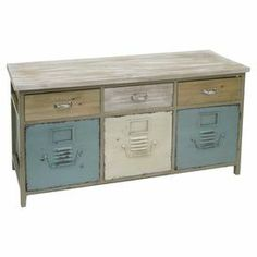 """Lend a touch of industrial-chic style to your decor with this handsome wood cabinet, showcasing metal accents and a cool blue palette.  Product: Cabinet Construction Material: Wood and metalColor: Blue, white and beige Features: Six drawers Dimensions: 20.25"""" H x 40.5"""" W x 13"""" D"""