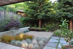 Good use of a small space  modern patio by Huettl Landscape Architecture