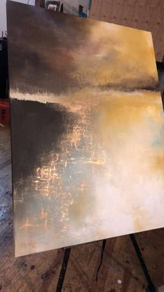 "This abstract landscape highlights the reflective water off a hazy horizon Brown, gold, yellow, auburn, blue This piece is highly textured and layered on 36"" x 48"" canvas with wide edges. The scene is painted over the edges so it does not have to be framed. If you are local to"