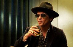 """bruno-mars-fanblog: """" xxgorillamarsxx: """" IMAGINE: Bruno whispering dirty things in your ear and then doing this afterwards… """" Gulp it """" I enjoy this very much. Lucky fucking glass."""