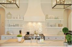 open shelves with all white cabinets and white backsplash