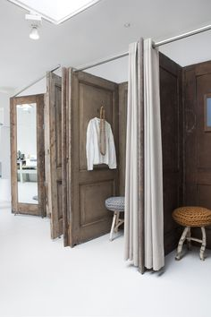 Dressing Room Cubicles ~ created from upcycled doors with curtain closure - cute little twiggy stools, too - Sukha Amsterdam  (via lifeinsketch)