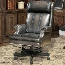 """This desk chair will be a great additon to your home office. It has a grey-smoke wipe color, with rolled arms and nailhead trim.  It measures:  27""""X36.25""""X47.5""""H"""