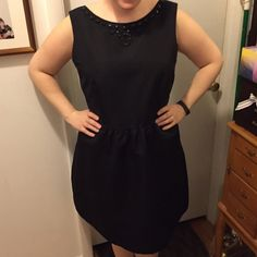 "Embellished Black Semi-formal Dress Size 14 Embellished Black Semi-formal Dress Size 14. This was my go-to LBD! It is made so well, and washes beautifully. The decorative beading at the neck really dresses this dress up! It is very figure flattering! I'm 5'4"" and this dress comes about 3"" below my knees. Dresses Midi"