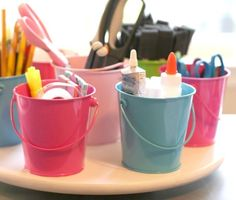 Make a Lazy Susan Supply Organizer - instead of gluing, you could try velcro on the bottom of the cans