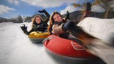 Slide 700 feet down snow-covered tubing lanes at Sugar Mountain. #visitnc