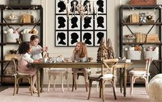Love this wall of silhouettes... I am going to have Cindi Rose make oversized silhouettes of my kids for the playroom