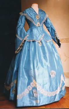 Two piece dress (bodice and skirt) in blue taffeta. c.1857