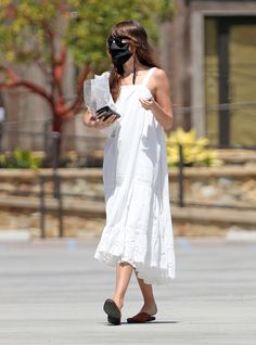 Dakota Johnson wore a lacy eyelet dress with Charvet slippers out in Los Angeles with boyfriend Chris Martin's daughter, Apple Martin. Estilo Dakota Johnson, Dakota Johnson Stil, Dakota Johnson Street Style, Dakota Style, Dakota Jhonson, White Midi Dress, White Dress Outfit, Summer Outfits, Summer Dresses
