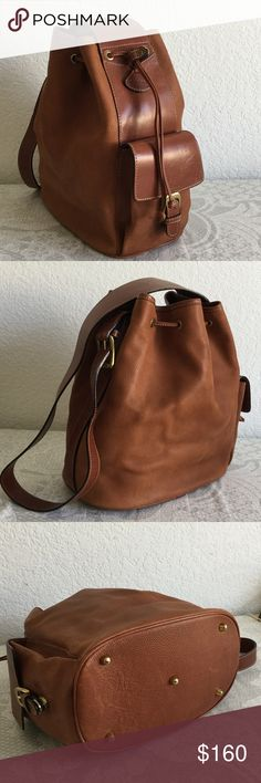 """Bally cross body bucket bag 100% leather. Has scuff and marks as show in picture. Authentic. Strap drop 19"""". Lining looks clean. 1 zipper pocket inside. 1 megnetic snap pocket outside. Come with Key chain. NO trade!!! Bally Bags Crossbody Bags"""