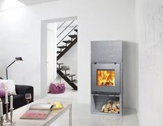 Featuring a wood compartment, stove with high inertia is for heating. Can be added to it accumulante a mass of 90 kg for prolonging the heating even after the fire. Soapstone, Foyer, Modern Design, Home Appliances, Contemporary, Wood, Furniture, Fireplaces, Home Decor