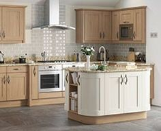 John Lewis Core Collection kitchens - I like this mix of wood and pale paint