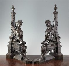 A pair of 18th century bronze andirons, modelled with sphinxes