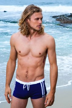 """Fabulous solid Squarecut with boardshort-inspired details are sure to turn heads at the beach. The Riviera Swim Short is a tight fitting swim short. White tie in front, band, and sidestripes on both"