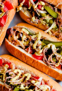 Windy City Dogs- with a Twist — Fancy Chicago-Style Hot Dogs topped with celery salt fried onions, Dijon mustard, cornichon, spicy sport peppers, and chopped tomato! Insanely delicious and easy tailgating food. Gourmet Hot Dogs, Hot Dog Chili, Chili Dogs, Hamburgers, Party Food Hot Dogs, Easy Tailgate Food, Tailgating, Sausage Recipes, Cooking Recipes