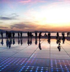 sun salutation at sunset. zada. croatia