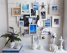 Here is my summer beach mantel. I added sea images to a layered photo frame gallery and added beach accessories for  summer decoration in bl... I like the starfish and the ones she dyed navy I love all the blue and white