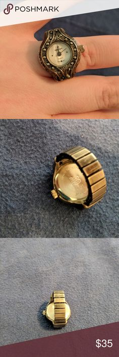 """Vintage Japan Movt Digit Finger Ring 🔹In excellent, beautiful condition vintage finger ring.  🔹Sold as is, buyer will need to purchase battery on their own.  🔹Fits a size 7 but can stretch to size 14 on ringer sizer. I recommend no larger than a size 12 for comfort purposes.  🔹Unique face with jewel studs surrounding face of watch and engravings outside of the studs.  🔹Stamped """"water resistant 100ft"""" on back of watch face.  🔹 Absolutely beautiful and unique! Digit Jewelry"""
