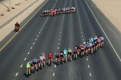 The peloton splits in the crosswinds and as the riders make their way down the highway on #stageone of the 2015 #TourofQatar