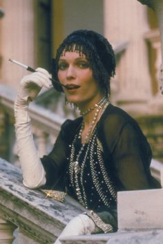 The Great Gatsby - Mia Farrow as Daisy Buchanan wearing a fringed headpiece, a crystal embellished chiffon dress and white leather opera gloves.
