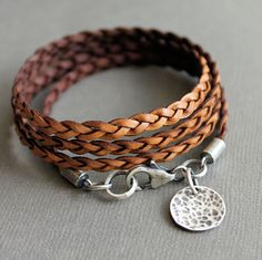 Leather Wrap Bracelet Brown Thin Flat Braid Sterling Silver Charm. $58.00, via Etsy.