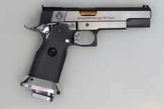 """I'm thinking about what I call a """"Militia-issue M1911A1"""". It is a custom M1911A1, with threaded match barrel, tactical rail, high night-sights, match grade trigger and hammer. It even comes with high-cap 15 round magazines! It may be little more effective than a standard M1911A1, but hey, at least it is better to get 1911 before 911."""