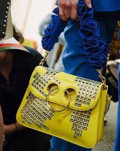 J.W. Anderson yellow studded pierce bag