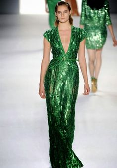 """Kate with a """"modesty panel"""" or bespoke slightly higher neckline. Deep cleavage on this green sequins Jenny Packham dress"""