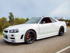 White Nissan Skyline GT-R 34.