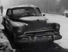 1950's. 1951 Chrysler Imperial (RG-58-85) parked on a street in snowy Amsterdam. #amsterdam #1950's.
